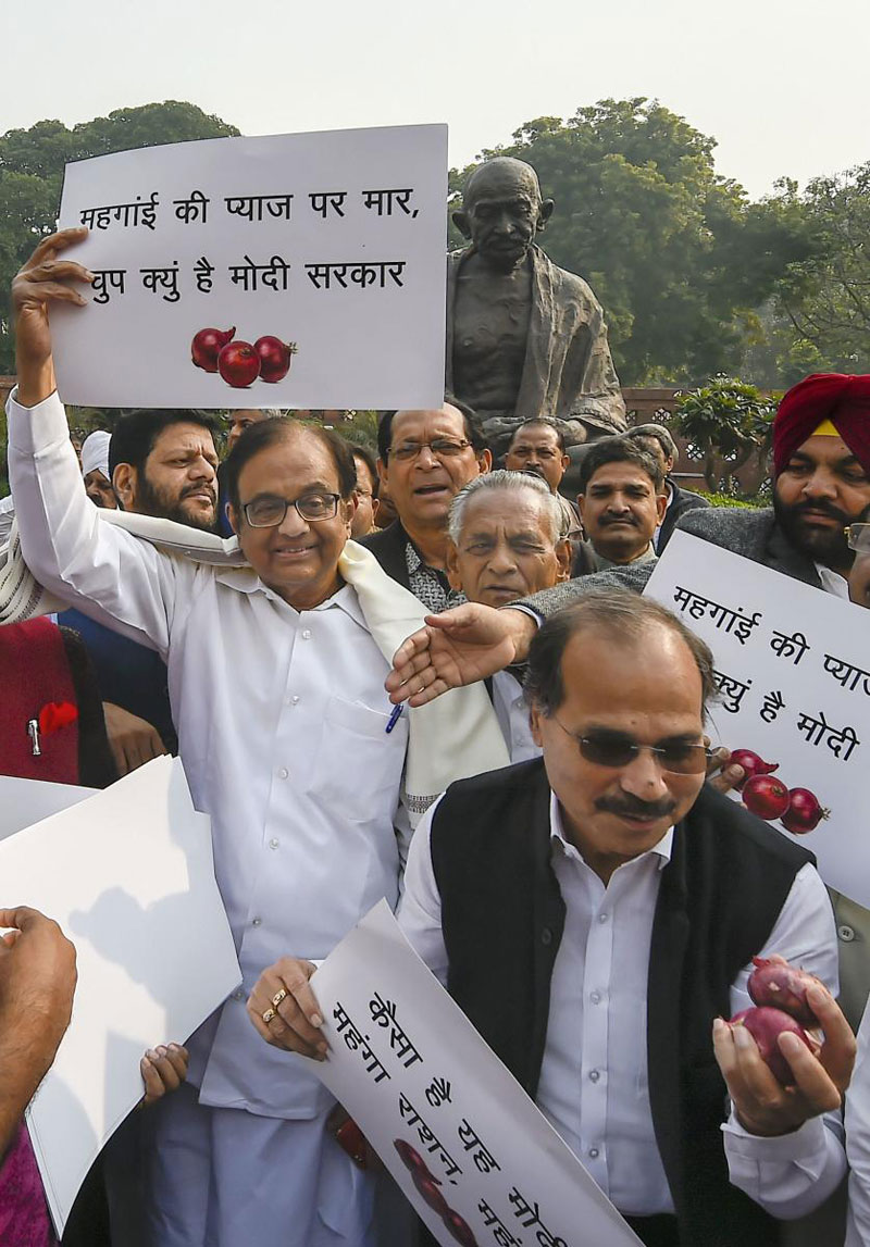 Congress leaders P Chidambaram, Adhir Ranjan Chowdhury and others stage a protest against hike in onion prices at Parliament during the ongoing Winter session,
