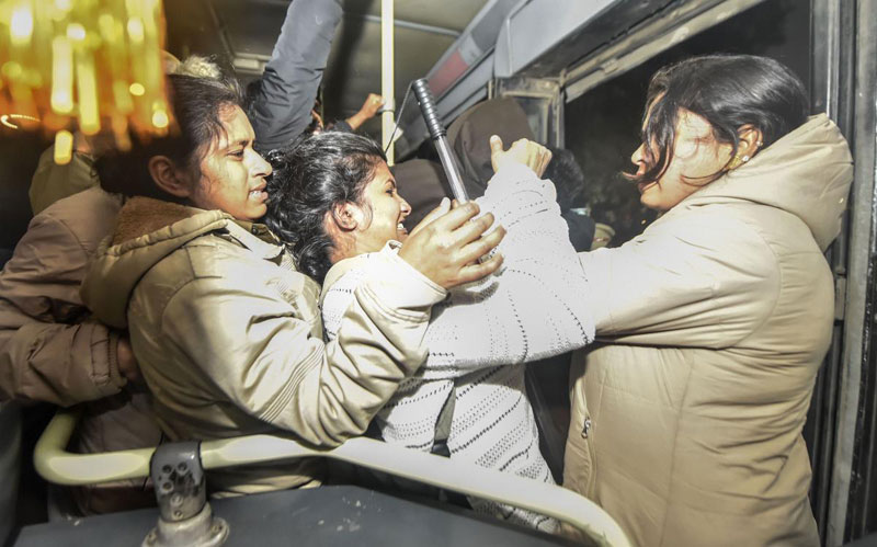 Delhi police detain Jawaharlal Nehru University (JNU) students who were protesting outside the Shastri Bhawan against January 5 violence on the university campus