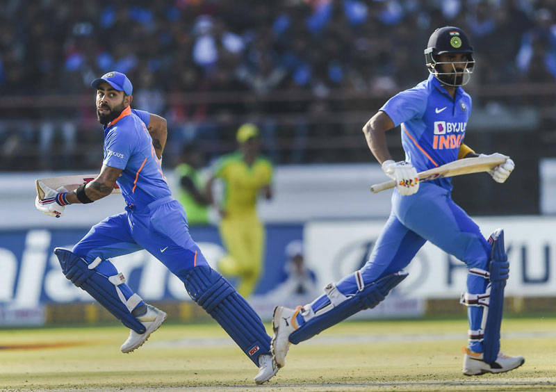 Indian batsman KL Rahul and Virat Kohli run between the wickets during the second one day international (ODI) cricket match between India and Australia
