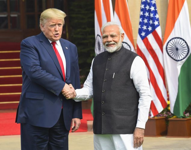 Prime Minister Narendra Modi shakes hands with US President Donald Trump prior to their meeting at Hyderabad House, in New Delhi