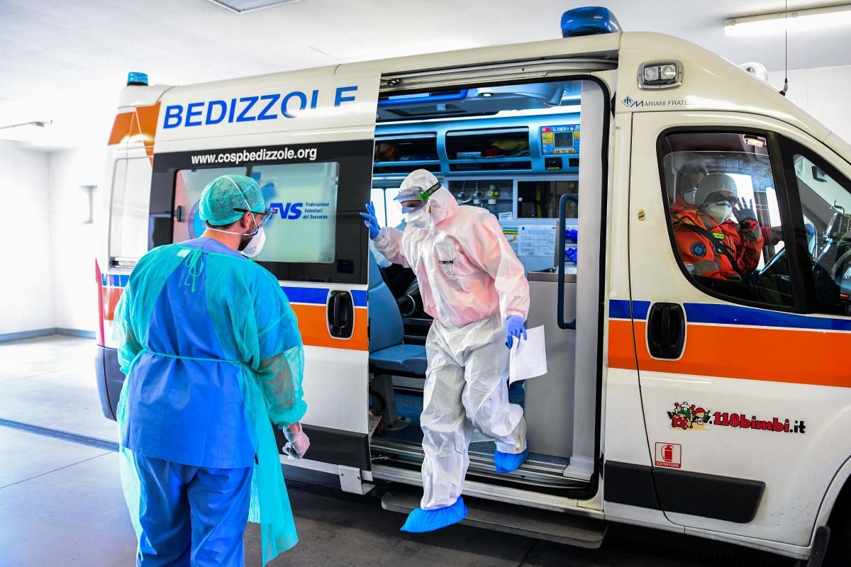 A medical worker brings a patient at ICU of the Brescia Poliambulanza hospital, Lombardy
