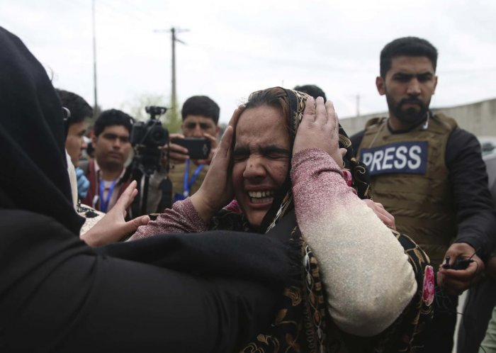 Family members cry after an attack in Kabul, Afghanistan, Wednesday, March 25, 2020. Credit: AP Photo