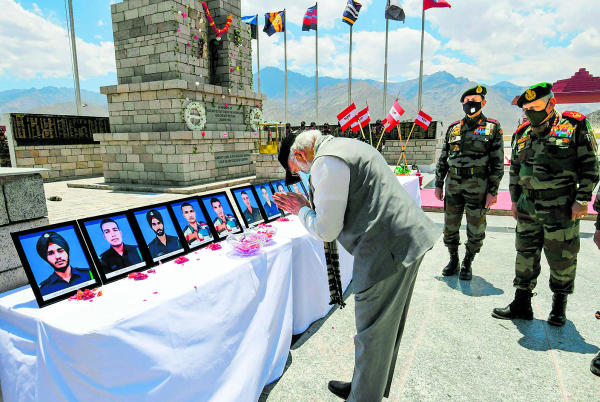 PM Narendra Modi pays tribute to the martyrs at a memorial, during his visit to a forward location in Nimu in Ladakh