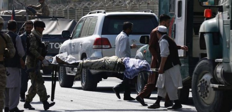 Afghan men carry a victim after a blast in Kabul, Afghanistan. Credit: Reuters Photo