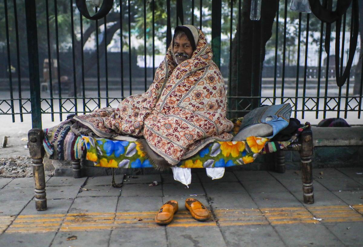 New Delhi: A man covers himself with a blanket during a cold winter morning, in New Delhi, Thursday, Dec. 31, 2020. PTI Photo