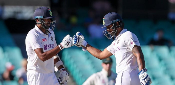 Ravichandran Ashwin (L) and teammate Hanuma Vihari. Credit: AFP Photo