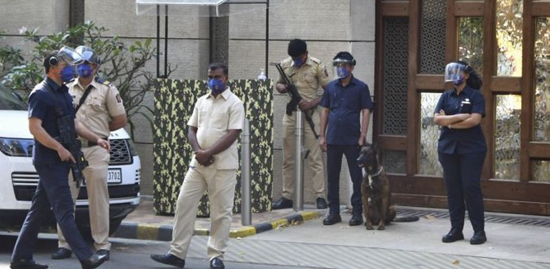 Police personnel guard outside industrialist Mukesh Ambai's residence Antilla. Credit: PTI Photo