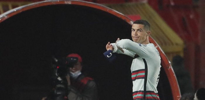 Cristiano Ronaldo holds his captain armband moments before he threw it to the ground. Credit: AFP Photo