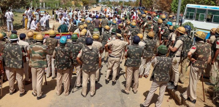Police stop farmers who were staging a protest during Haryana Chief Minister Manohar Lal's visit to Rohtak. Credit: PTI photo.