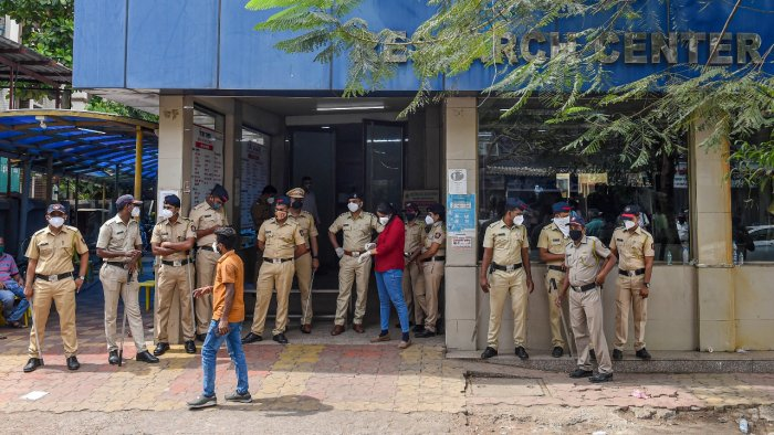 Police personnel stand outside the Vijay Vallabh Covid care hospital after a fire in Virar West, on the outskirts of Mumbai, Friday, April 23, 2021. Credit: PTI Photo