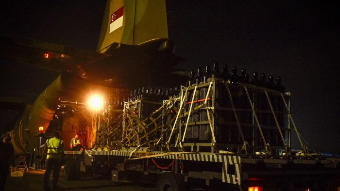 A consignment of oxygen cylinders being loaded onto a Republic of Singapore Air Force C-130 aircraft to be sent to West Bengal. Credit: AFP Photo/Singapore's Ministry of Defence